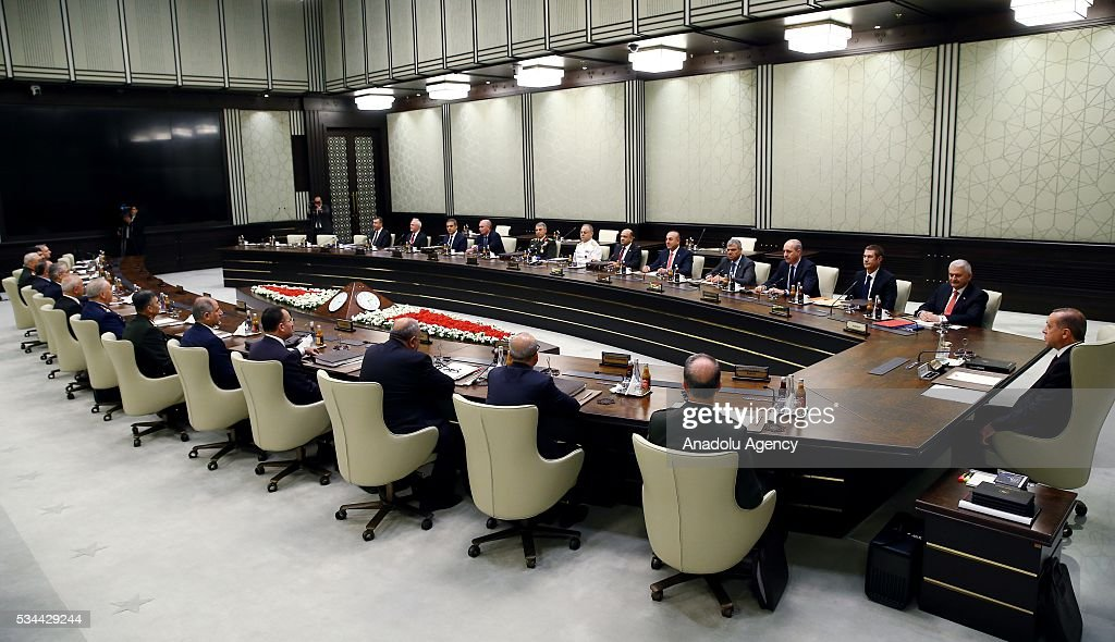 Turkish President Recep Tayyip Erdogan (R) chairs a meeting of the National Security Council (MGK) at the Presidential Palace in Ankara, Turkey on May 26, 2016.