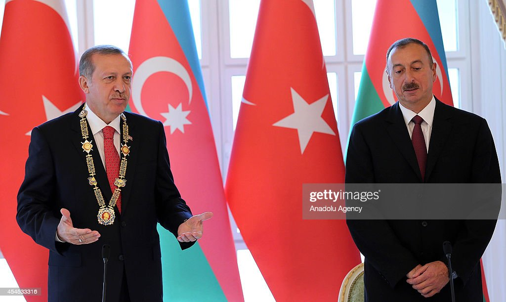 Turkish President Recep Tayyip Erdogan (L) delivers a speech after being honored with Heydar Aliyev Order by Azerbaijani President Ilham Aliyev (R) in the capital city Baku, Azerbiajan on September 3, 2014.