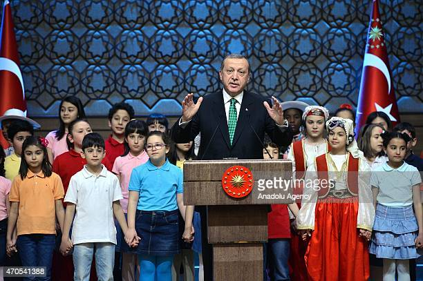 Turkish President Recep Tayyip Erdogan delivers a speech as he receives children at the Presidential Palace for the TRT International 23 April...