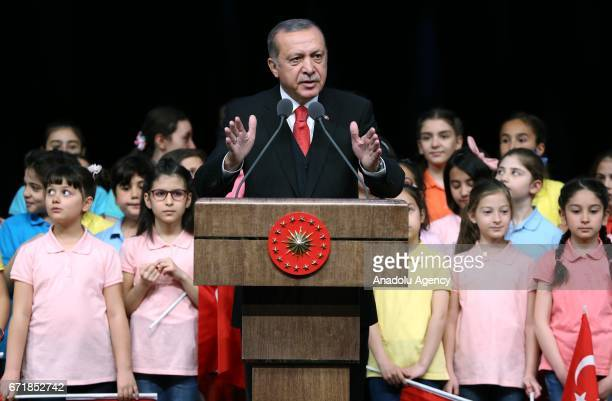Turkish President Recep Tayyip Erdogan delivers a speech as he receives children at Bestepe People's Culture and Congress Center during a ceremony as...