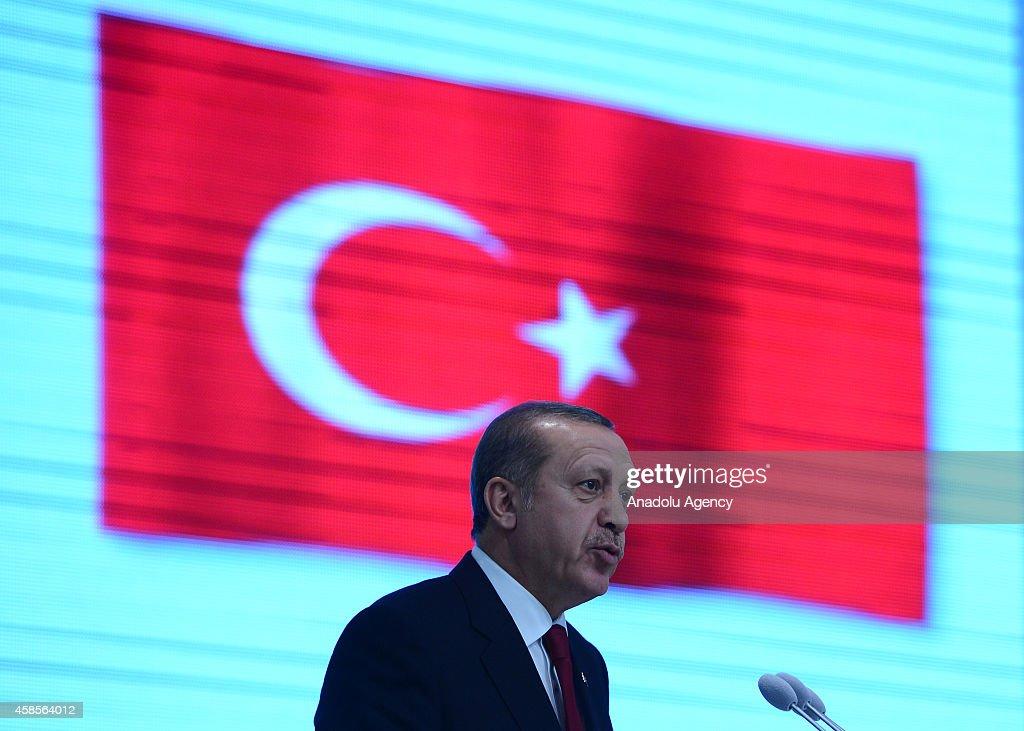 Turkish President Recep Tayyip Erdogan delivers a speech during the TurkmenTurkish business forum held at Mizan business center in Ashgabat...