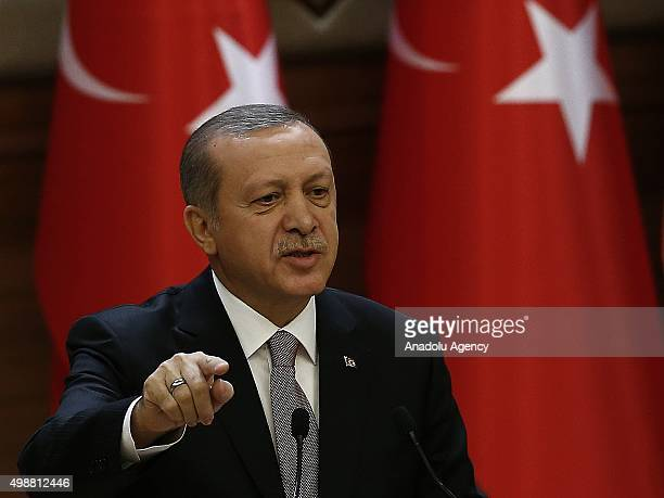Turkish President Recep Tayyip Erdogan delivers a speech during the mukhtars meeting at the presidential palace in Ankara Turkey on November 26 2015