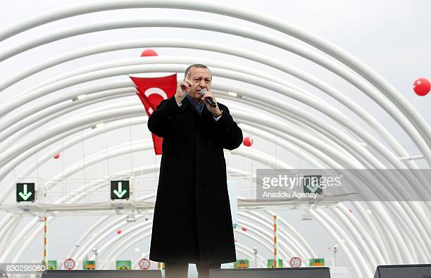 Turkish President Recep Tayyip Erdogan delivers a speech during the opening ceremony of the Eurasia Tunnel connecting Asian and European sides under...