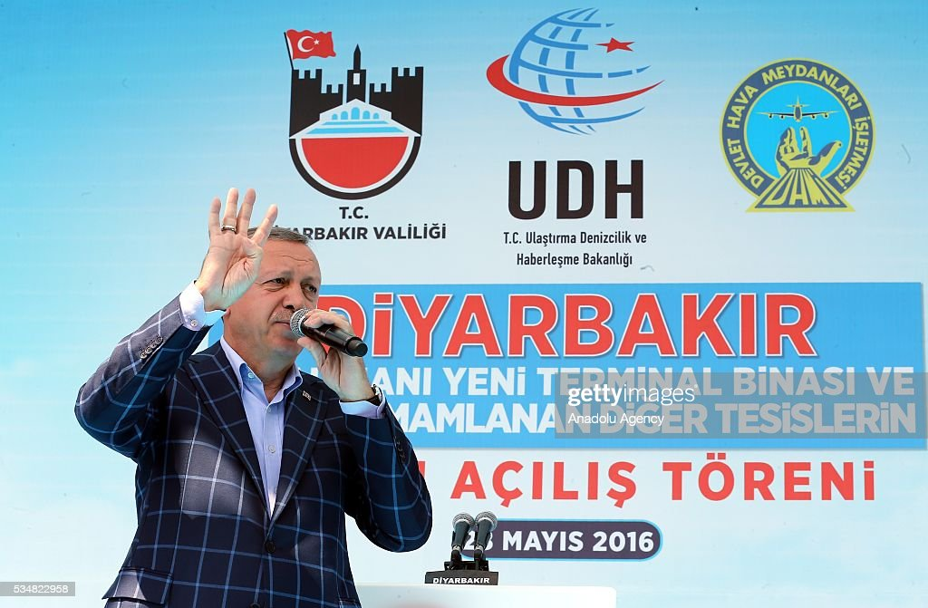 Turkish President Recep Tayyip Erdogan delivers a speech with 'Rabia sign' during an opening ceremony in Diyarbakir, Turkey on May 28, 2016.