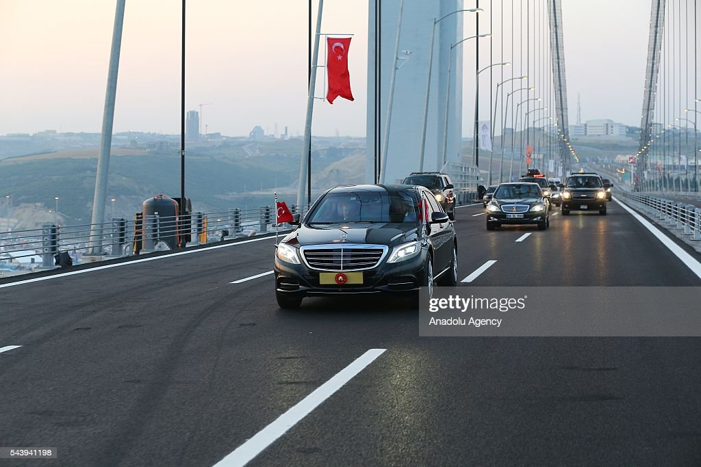 Turkish President Recep Tayyip Erdogan drives across the bridge with Turkish Prime Minister Binali Yildirim during the opening ceremony of Osmangazi Bridge in Kocaeli, Turkey on June 30, 2016. Osmangazi Bridge is the fourth-longest suspension bridge in the world and second-longest bridge in Europe.