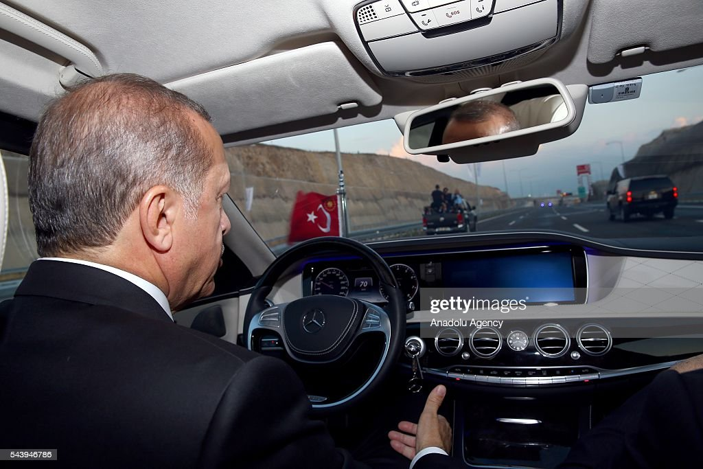 Turkish President Recep Tayyip Erdogan drives across the Osmangazi bridge with Turkish Prime Minister Binali Yildirim (not seen) during the opening ceremony of Osmangazi Bridge in Kocaeli, Turkey on June 30, 2016. Osmangazi Bridge is the fourth-longest suspension bridge in the world and second-longest bridge in Europe.