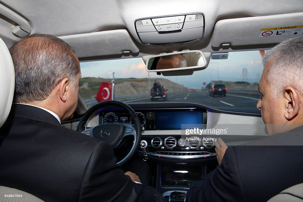 Turkish President Recep Tayyip Erdogan (L) drives across the Osmangazi bridge with Turkish Prime Minister Binali Yildirim (R) during the opening ceremony of Osmangazi Bridge in Kocaeli, Turkey on June 30, 2016. Osmangazi Bridge is the fourth-longest suspension bridge in the world and second-longest bridge in Europe.
