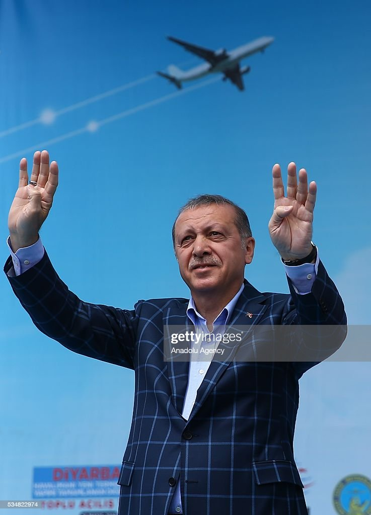 Turkish President Recep Tayyip Erdogan gestures with 'Rabia sign' during an opening ceremony in Diyarbakir, Turkey on May 28, 2016.