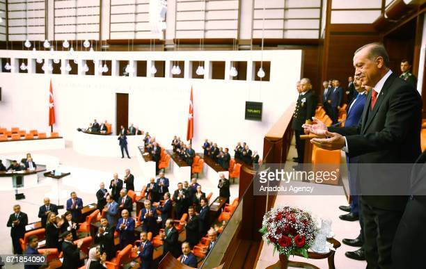 Turkish President Recep Tayyip Erdogan greets deputies during the special session at TBMM as part of the 97th anniversary of foundation of Grand...