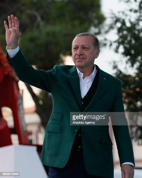 Turkish President Recep Tayyip Erdogan greets people as he attends the mass opening ceremony at the Republic Square in Manisa Turkey on November 3...