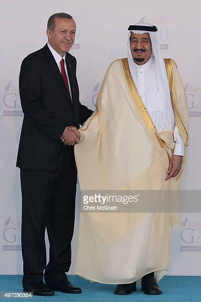 Turkish President Recep Tayyip Erdogan greets Saudi Arabia's King Salman bin Abdulaziz during the official welcome ceremony on day one of the G20...