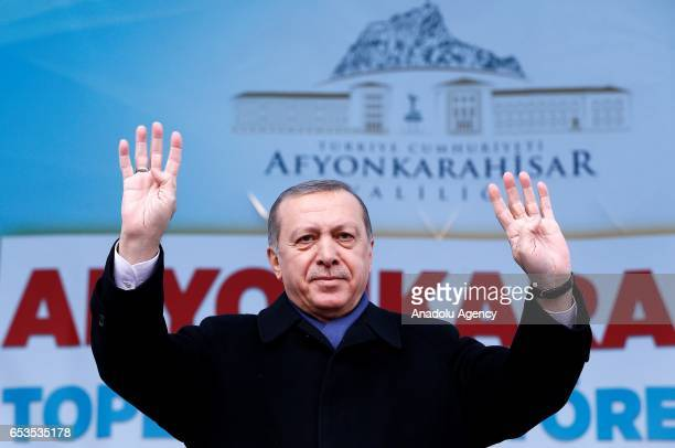Turkish President Recep Tayyip Erdogan greets the crowd during a mass opening ceremony at Republic Square in Afyonkarahisar Turkey on March 15 2017
