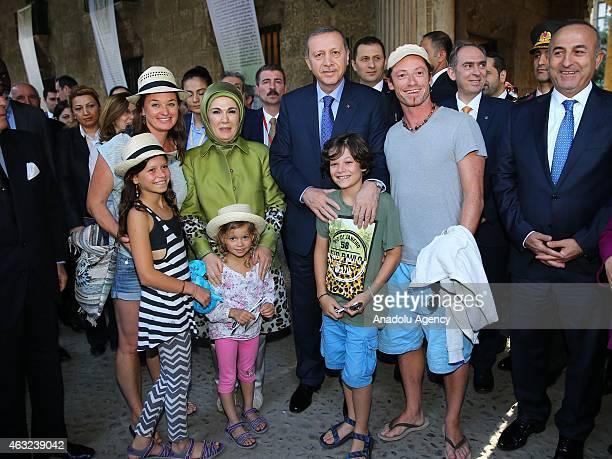 Turkish President Recep Tayyip Erdogan his wife Emine Erdogan and Turkish Foreign Minister Mevlut Cavusoglu pose with Turkish people during his...
