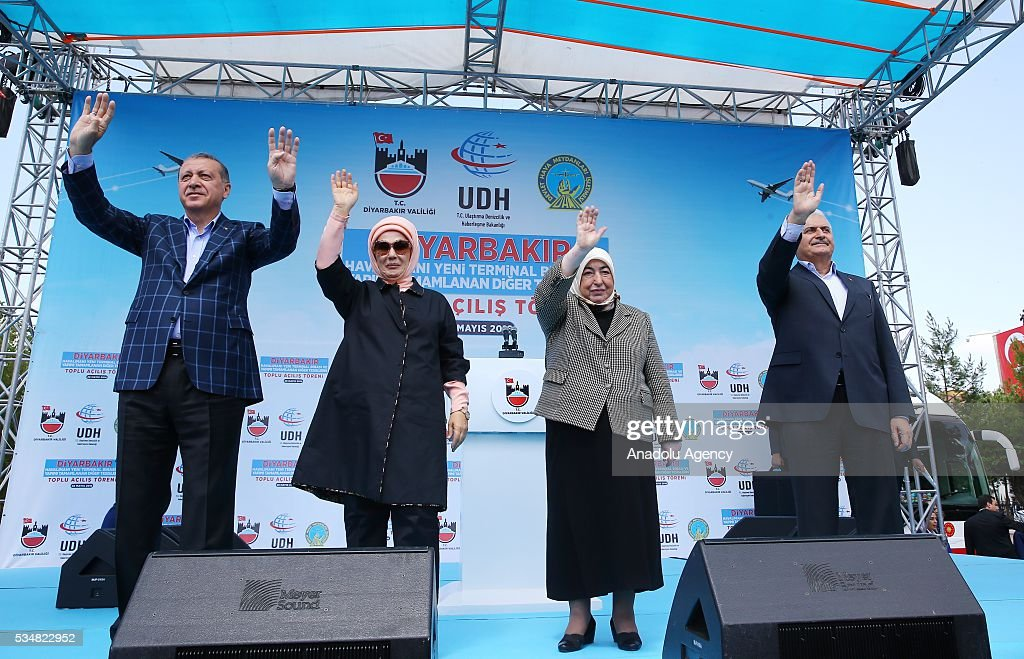 Turkish President Recep Tayyip Erdogan (L), his wife Emine Erdogan (2nd L), Turkish Prime Minister Binali Yildirim (R) and his wife Semiha Yildirim (2nd R) salute the citizens during an opening ceremony in Diyarbakir, Turkey on May 28, 2016.