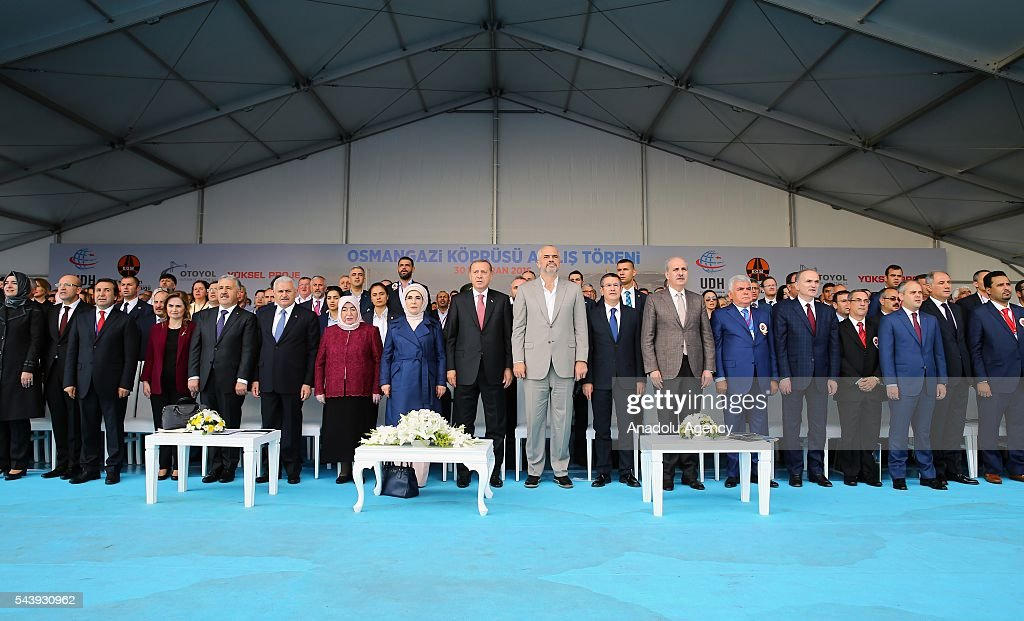 Turkish President Recep Tayyip Erdogan (9th L), his wife Emine Erdogan (8th L), Turkish Prime Minister Binali Yildirim (6th L), his wife Semiha Yildirim (7th L) and Albanian Prime Minister Edi Rama (9th R) attend the opening ceremony of Osmangazi Bridge in Kocaeli, Turkey on June 30, 2016. Osmangazi Bridge is the fourth-longest suspension bridge in the world and second-longest bridge in Europe.