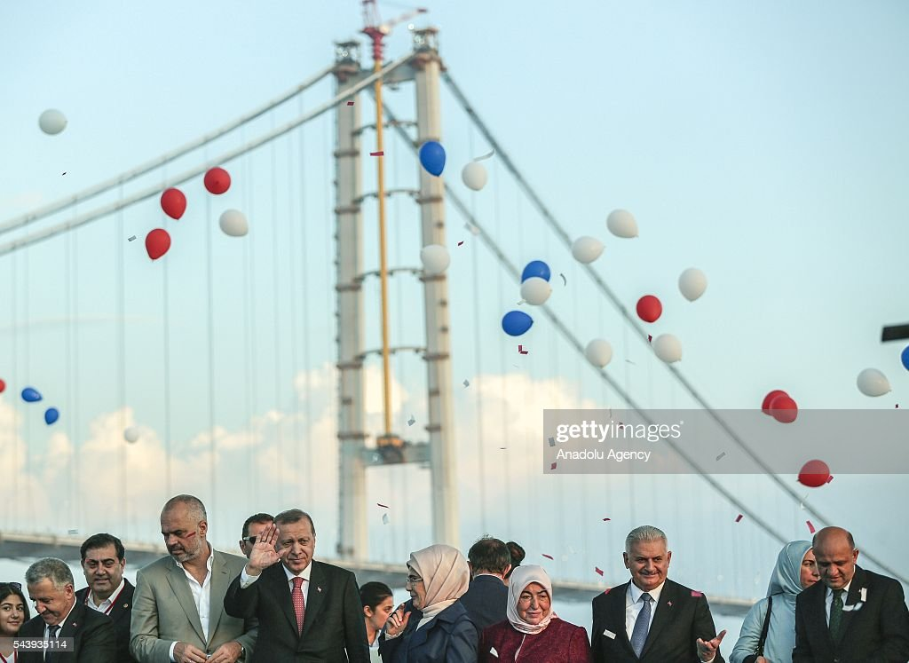 Turkish President Recep Tayyip Erdogan (5th L), his wife Emine Erdogan (4th R), Turkish Prime Minister Binali Yildirim (2nd R), his wife Semiha Yildirim (3rd R), Albanian Prime Minister Edi Rama (4th L), attend the opening ceremony of Osmangazi Bridge in Kocaeli, Turkey on June 30, 2016. Osmangazi Bridge is the fourth-longest suspension bridge in the world and second-longest bridge in Europe.