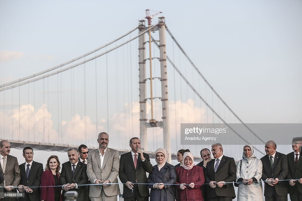 Turkish President Recep Tayyip Erdogan (6th L), his wife Emine Erdogan (7th L), Turkish Prime Minister Binali Yildirim (4th R), his wife Semiha Yildirim (5th R), Albanian Prime Minister Edi Rama (5th L), attend the opening ceremony of Osmangazi Bridge in Kocaeli, Turkey on June 30, 2016. Osmangazi Bridge is the fourth-longest suspension bridge in the world and second-longest bridge in Europe.