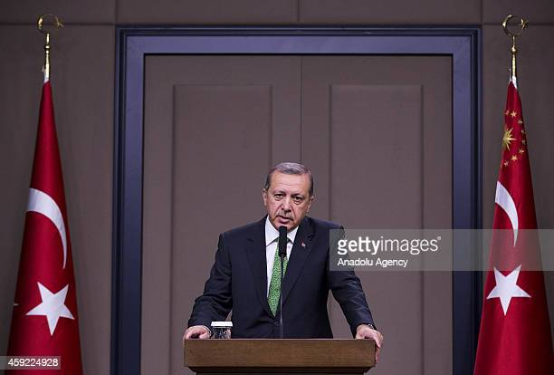Turkish President Recep Tayyip Erdogan holds a press conference at the Esenboga Airport ahead of his official visit to Algeria on November 19 in...