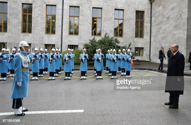 Turkish President Recep Tayyip Erdogan inspects honor guards during a welcoming ceremony as he arrives to attend the parliament's special session at...