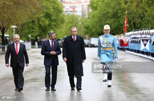 Turkish President Recep Tayyip Erdogan is welcomed by Deputy Speaker of the Turkey's Grand National Assembly Ahmet Aydin with an official ceremony as...