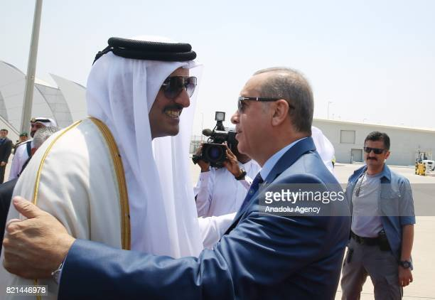 Turkish President Recep Tayyip Erdogan is welcomed by Emir of Qatar Sheikh Tamim bin Hamad Al Thani in Doha Qatar on July 24 2017