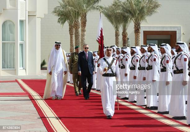 Turkish President Recep Tayyip Erdogan is welcomed by Emir of Qatar Sheikh Tamim bin Hamad Al Thani with an official ceremony during his official...
