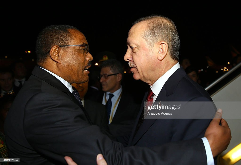 Turkish President Recep Tayyip Erdogan (R) is welcomed by Ethiopian Prime Minister Hailemariam Desalegn (L) at the Addis Ababa Bole International Airport in Addis Ababa, Ethiopia on January 21, 2015. Ethiopia is the first leg of Recep Tayyip Erdogan's three-day African tour.