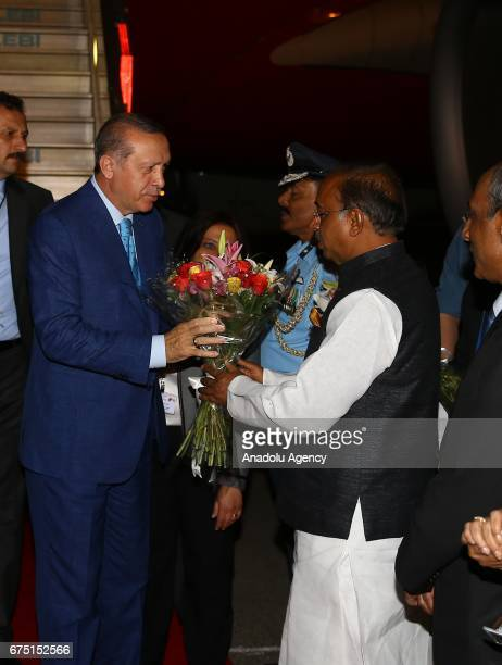 Turkish President Recep Tayyip Erdogan is welcomed by Indian Minister of Youth Affairs and Sports Vijay Goel Turkish Ambassador to India Sakir Ozkan...
