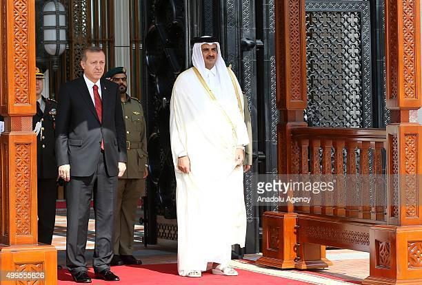 Turkish President Recep Tayyip Erdogan is welcomed by Qatar's Emir Sheikh Tamim bin Hamad Al Thani prior to their meeting in Doha Qatar in December 2...