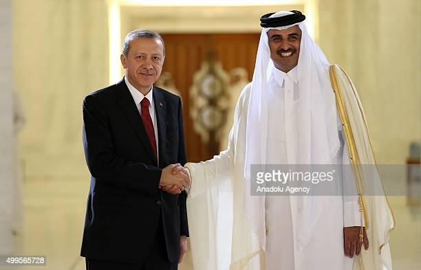 Turkish President Recep Tayyip Erdogan is welcomed by Qatar's Emir Sheikh Tamim bin Hamad Al Thani prior to their meeting in Doha Qatar in December...