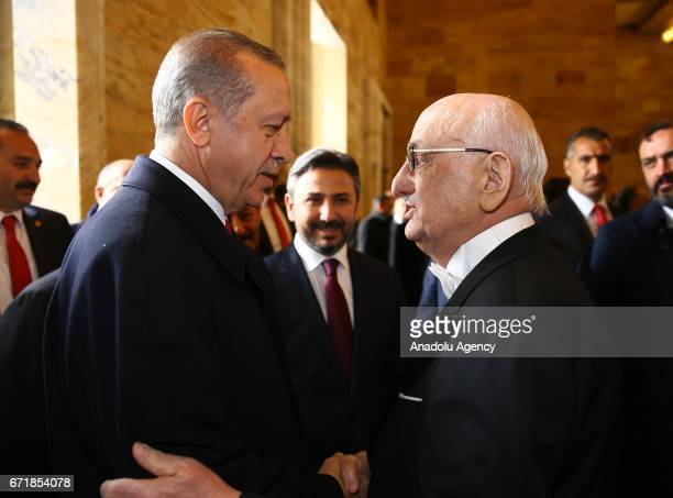 Turkish President Recep Tayyip Erdogan is welcomed by Speaker of the Grand National Assembly of Turkey Ismail Kahraman as he arrives to attend the...