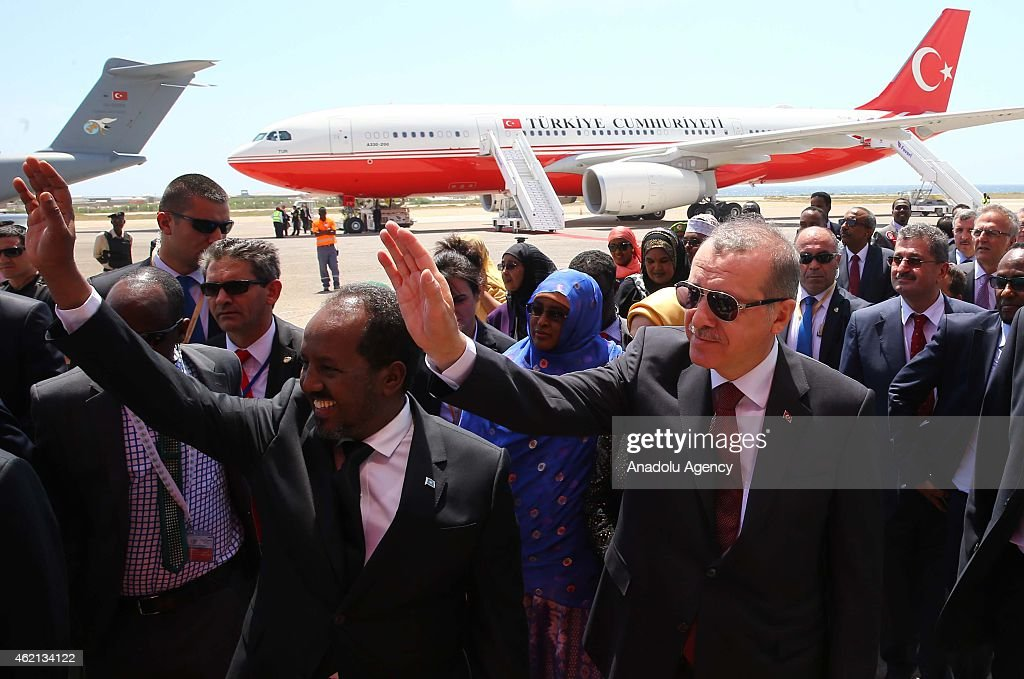 Turkish President Recep Tayyip Erdogan (R) is welcomed with an official ceremony by Somalian President Hassan Sheikh Mohamoud (L) at the airport in Mogadishu, Somalia on January 25, 2015.