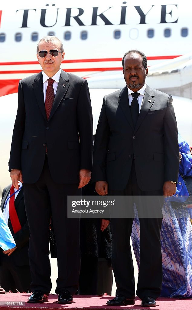 Turkish President Recep Tayyip Erdogan (L) is welcomed with an official ceremony by Somalian President Hassan Sheikh Mohamoud (R) at the airport in Mogadishu, Somalia on January 25, 2015.