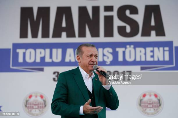 Turkish President Recep Tayyip Erdogan makes a speech as he attends the mass opening ceremony at the Republic Square in Manisa Turkey on November 3...
