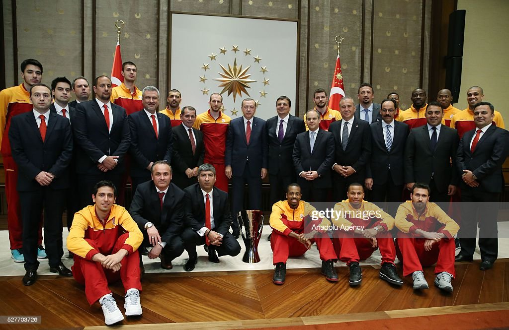 Turkish President Recep Tayyip Erdogan (R) meets with champion of ULEB Eurocup - Galatasaray Men's Basketball Team at Presidential Complex in Ankara, Turkey on May 3, 2016.