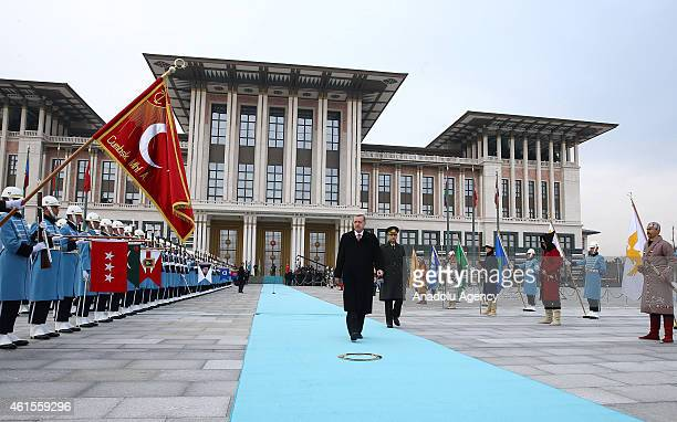 Turkish President Recep Tayyip Erdogan passes by the guard of honor before Azerbaijani President Ilham Aliyev arrives at Turkey's Presidential Palace...