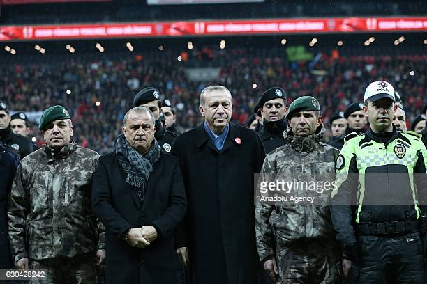 Turkish President Recep Tayyip Erdogan poses for a photo with Turkish police members and head coach of the Turkish National Soccer Team Fatih Terim...