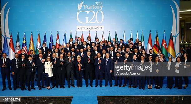 Turkish President Recep Tayyip Erdogan poses together with personnel who assigned for G20 Summit in Antalya Turkey on November 16 2015