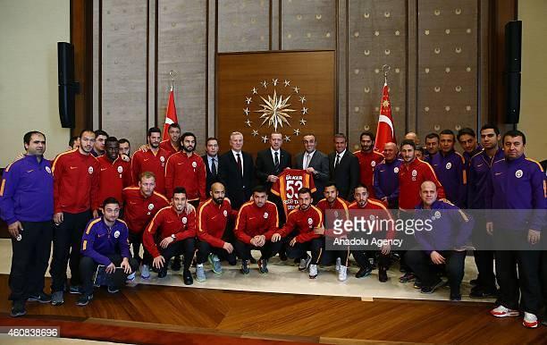 Turkish President Recep Tayyip Erdogan poses with Galatasaray's vice president Abdurrahim Albayrak Member of the board of Galatasaray Sportif Inc Ali...