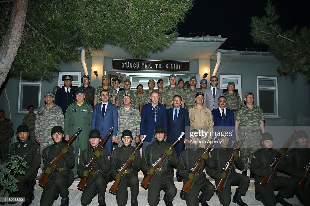 Turkish President Recep Tayyip Erdogan (2nd row 5th L) poses with soldiers as he visits 172. Armored Brigade Command's 3. Tank Battalion campus prior to a Iftar (fast-breaking) Dinner in Cizre District of Sirnak, Turkey on Islamic holy month Ramadan on June 25, 2016.
