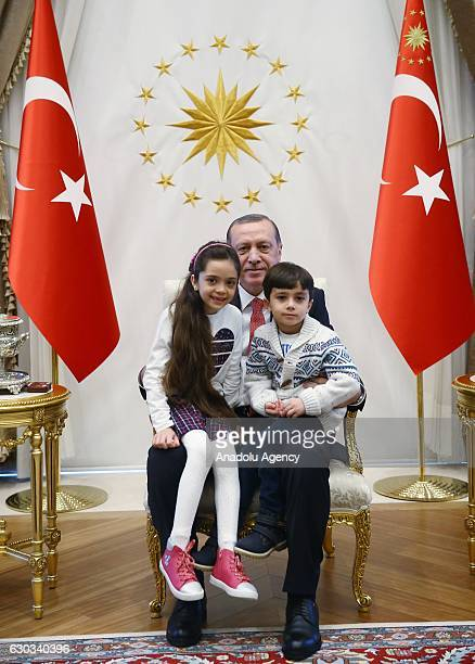 Turkish President Recep Tayyip Erdogan poses with Syrian Bana Alabed sevenyearold girl who tweeted on attacks from Aleppo and her brother at...