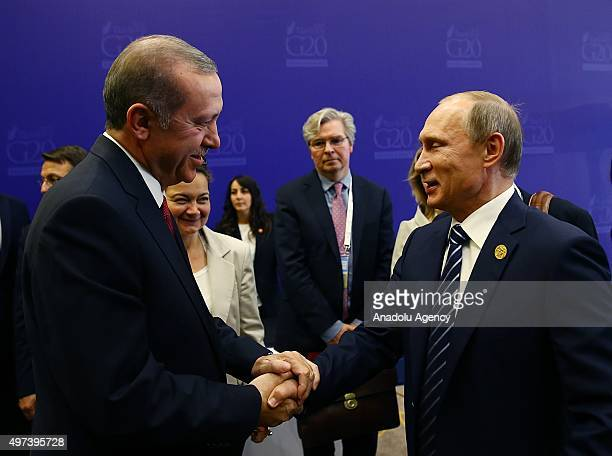 Turkish President Recep Tayyip Erdogan presents personalized stamps to Russian President Vladimit Putin in remembrance of G20 Turkey Leaders Summit...