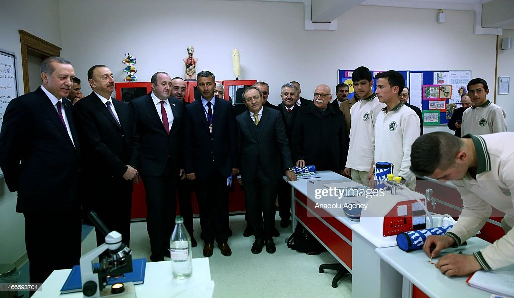 Turkish President <a gi-track='captionPersonalityLinkClicked' href=/galleries/search?phrase=Recep+Tayyip+Erdogan&family=editorial&specificpeople=213890 ng-click='$event.stopPropagation()'>Recep Tayyip Erdogan</a> (L), President of Azerbaijan <a gi-track='captionPersonalityLinkClicked' href=/galleries/search?phrase=Ilham+Aliyev&family=editorial&specificpeople=565601 ng-click='$event.stopPropagation()'>Ilham Aliyev</a> (L 2) and Georgian President <a gi-track='captionPersonalityLinkClicked' href=/galleries/search?phrase=Giorgi+Margvelashvili&family=editorial&specificpeople=10916956 ng-click='$event.stopPropagation()'>Giorgi Margvelashvili</a> (L 3) attend the opening ceremony of Heydar Aliyev Technical and Vocational High School in Kars city of eastern Turkey on March 17, 2015.