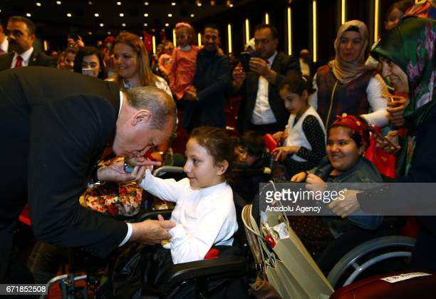 Turkish President Recep Tayyip Erdogan receives children at Bestepe People's Culture and Congress Center during a ceremony as part of the National...