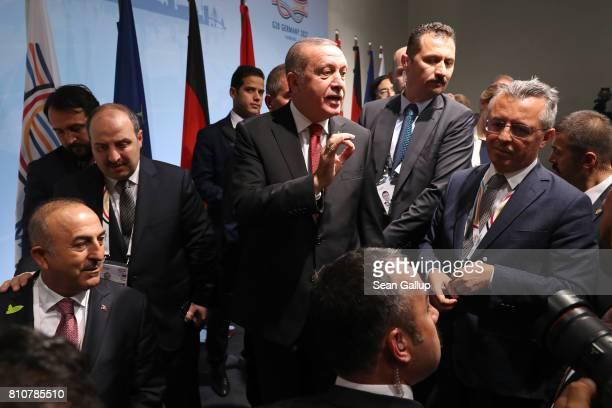 Turkish President Recep Tayyip Erdogan reponds to a German reporter's question regarding imprisoned German reporter in Turkey Deniz Yucel after...