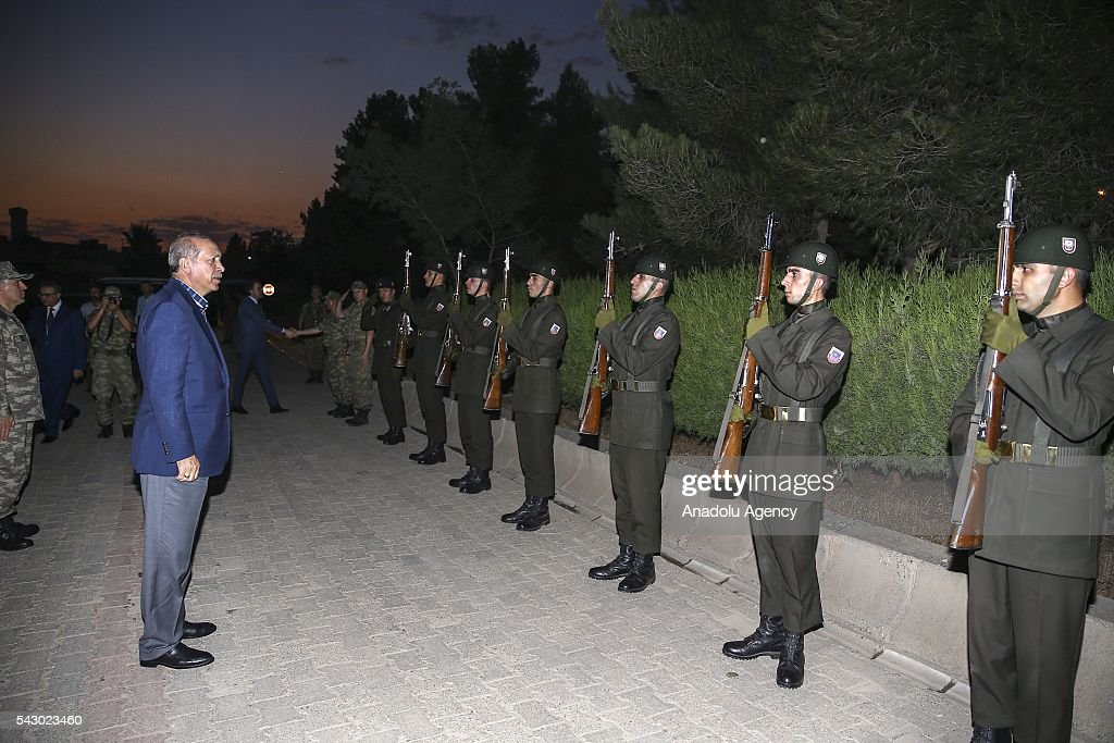 Turkish President Recep Tayyip Erdogan (L) salutes soldiers as he visits 172. Armored Brigade Command's 3. Tank Battalion campus prior to an Iftar (fast-breaking) Dinner in Cizre District of Sirnak, Turkey on Islamic holy month Ramadan on June 25, 2016.