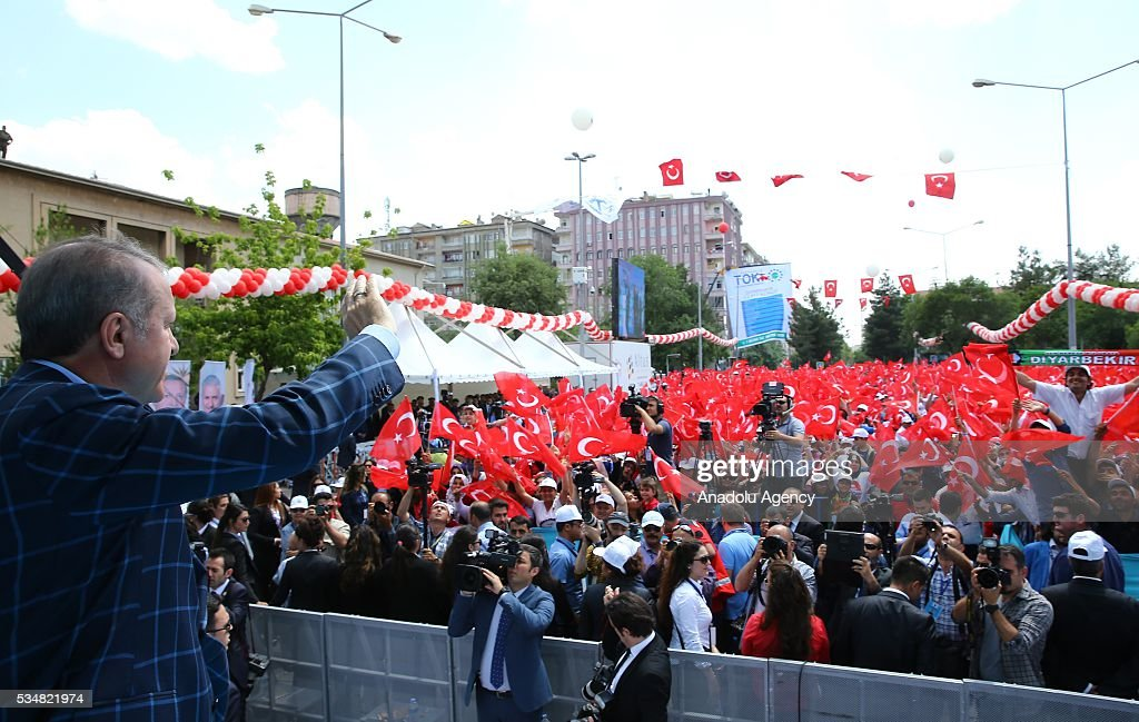 Turkish President Recep Tayyip Erdogan salutes the citizens during an opening ceremony in Diyarbakir, Turkey on May 28, 2016.