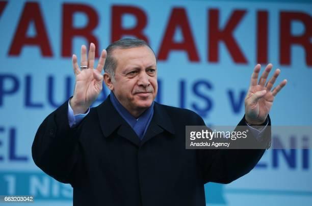 Turkish President Recep Tayyip Erdogan salutes the crowd during a mass opening ceremony in Diyarbakir Turkey on April 1 2017