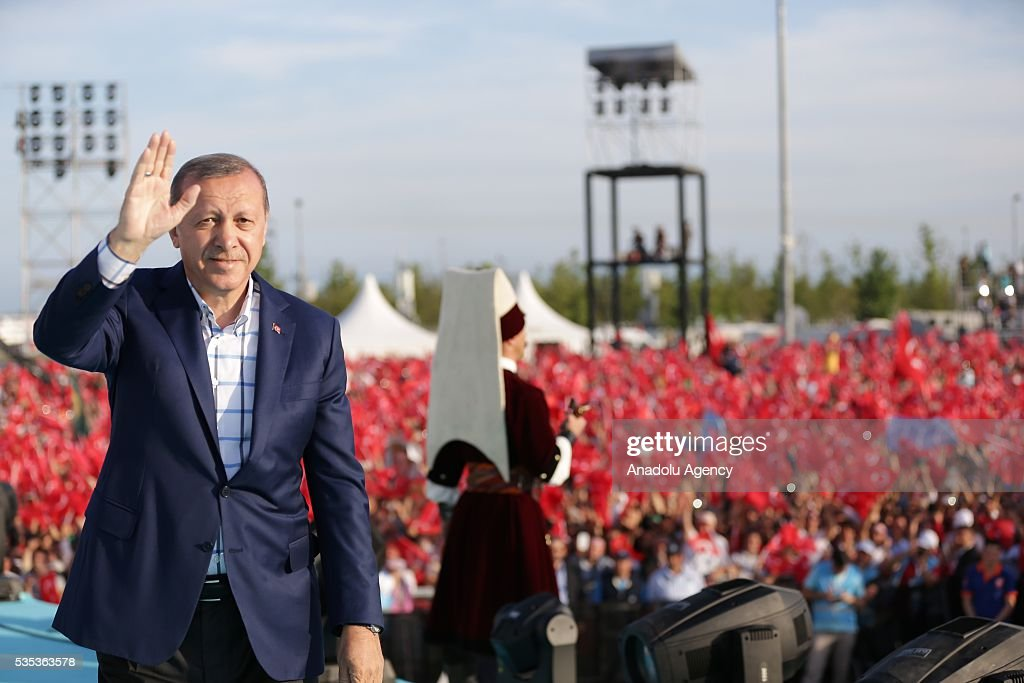 Turkish President Recep Tayyip Erdogan (L) salutes the people as he attend the celebrations of the 563rd anniversary of Istanbuls conquest by Turks at Yenikapi Event Area in Istanbul, Turkey on May 29, 2016. On May 29, 1453, Ottoman Sultan Mehmed II (Mehmet the Conqueror) conquered Istanbul, then called Constantinople, from where the Byzantines had ruled the Eastern Roman Empire for more than 1,000 years. The conquest transformed the city, once the heart of the Byzantine realm, into the capital of the new Ottoman Empire.