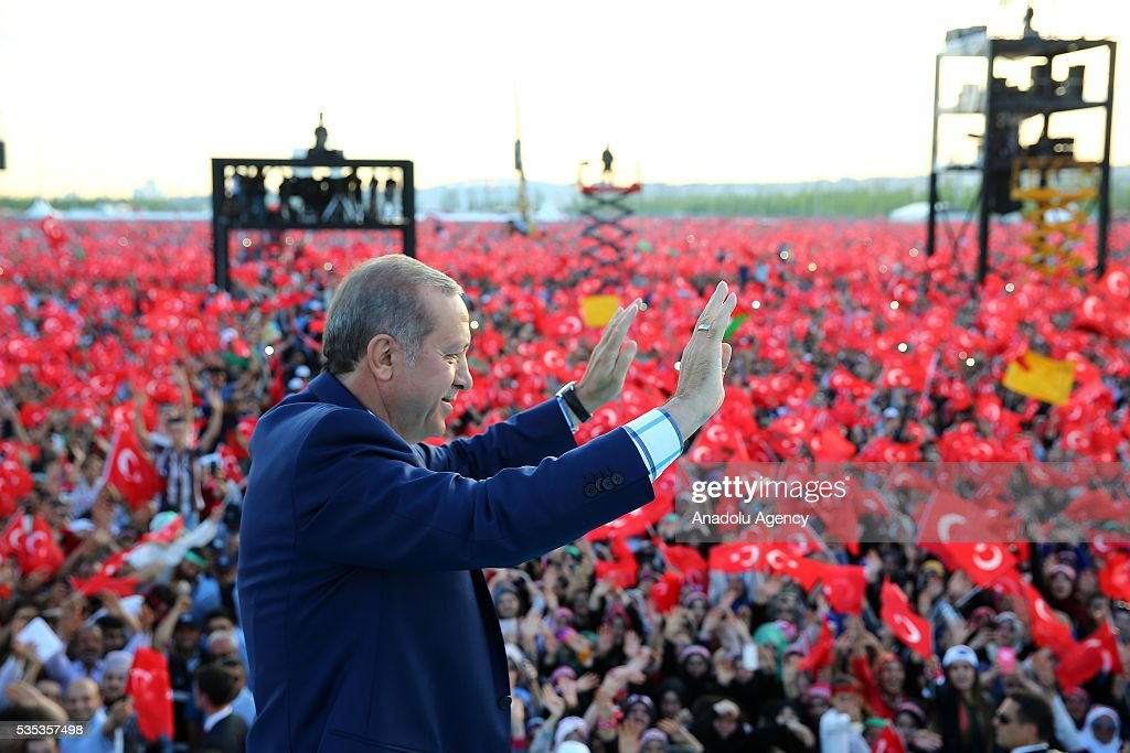 Turkish President Recep Tayyip Erdogan (C) salutes the people during the celebrations of the 563rd anniversary of Istanbuls conquest by Turks at Yenikapi Event Area in Istanbul, Turkey on May 29, 2016. On May 29, 1453, Ottoman Sultan Mehmed II (Mehmet the Conqueror) conquered Istanbul, then called Constantinople, from where the Byzantines had ruled the Eastern Roman Empire for more than 1,000 years. The conquest transformed the city, once the heart of the Byzantine realm, into the capital of the new Ottoman Empire.